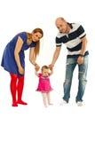 Pais com primeiras etapas do bebê Fotos de Stock Royalty Free