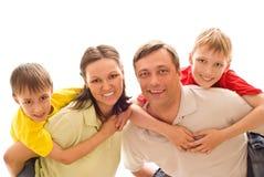 Pais com suas duas crianças Fotografia de Stock Royalty Free