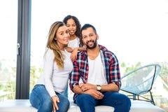 Pais novos com sua filha imagem de stock royalty free