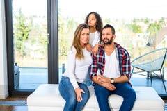 Pais novos com sua filha imagens de stock royalty free