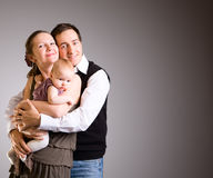 Pais novos felizes com filha do bebê Fotos de Stock Royalty Free