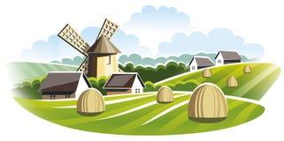 Paisagem agricultural Moinho de vento no campo Foto de Stock Royalty Free