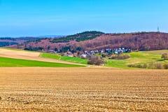 Paisagem com campos e uma vila Imagens de Stock Royalty Free