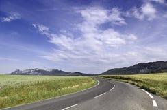 Paisagem com curva da estrada Imagens de Stock