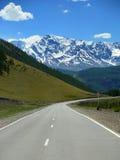 Paisagem com estrada da montanha Fotos de Stock Royalty Free