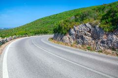 Paisagem com estrada e as árvores vazias Imagens de Stock Royalty Free