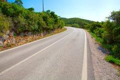 Paisagem com estrada e as árvores vazias Fotografia de Stock Royalty Free