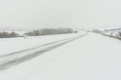 Paisagem com estrada e neve-tração Foto de Stock Royalty Free