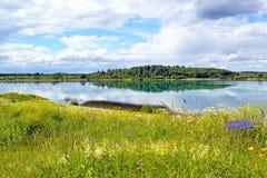 Paisagem com lago azul Imagem de Stock