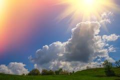 Paisagem com luz solar das nuvens Imagem de Stock Royalty Free