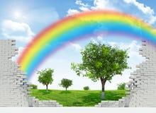 Paisagem com o arco-íris em parede quebrada Imagem de Stock Royalty Free