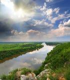 Paisagem com rio e chuva no horizonte Fotografia de Stock Royalty Free