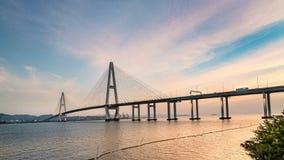 Paisagem da ponte sobre o mar no crepúsculo vídeos de arquivo