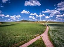 Paisagem das turbinas de vento A energia, sustentáveis renováveis e alteram-se Fotografia de Stock Royalty Free