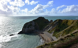 Paisagem de Dorset, mar, penhasco, céu nebuloso Fotos de Stock Royalty Free