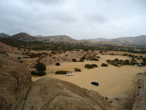 Paisagem do deserto com carros Imagens de Stock