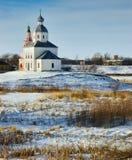 Paisagem do inverno com uma igreja Imagens de Stock Royalty Free