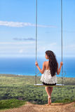 Paisagem do mar com uma menina no balanço Imagens de Stock Royalty Free