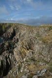 Paisagem do mar dos penhascos, perto de Eyemouth, de Northumberland e das beiras escocesas Fotos de Stock