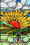 Paisagem do por do sol no vitral ilustração stock