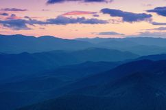 Paisagem do por do sol da montanha Imagens de Stock