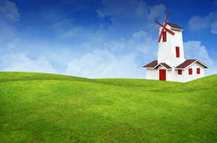 Paisagem e moinho de vento da grama verde Imagem de Stock
