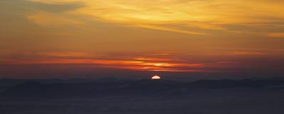 Paisagem larga do por do sol Imagem de Stock Royalty Free