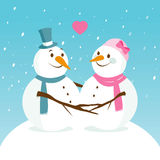 Paisagem nevado com os bonecos de neve bonitos no amor Fotografia de Stock