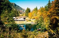 Paisagem no outono com uma casa Fotos de Stock