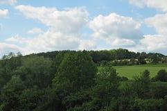 Paisagem rural com montes arborizados Imagem de Stock Royalty Free