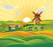 Paisagem rural com um moinho de vento Fotos de Stock Royalty Free