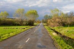 Paisaje con el camino secundario Foto de archivo libre de regalías