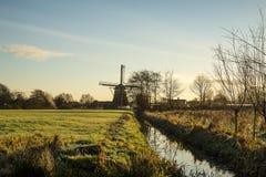 Paisaje con el molino de viento Fotos de archivo