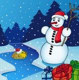Paisaje con el muñeco de nieve Foto de archivo libre de regalías