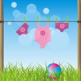 Paisaje con la ropa y una bola de los niños Imagen de archivo libre de regalías
