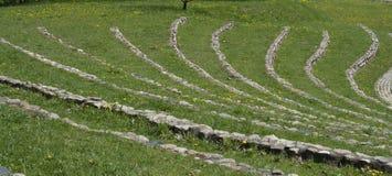 Paisaje con un anfiteatro de piedra Fotos de archivo libres de regalías