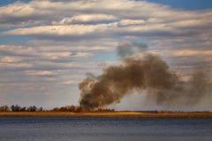 Paisaje con un humo Imagen de archivo libre de regalías