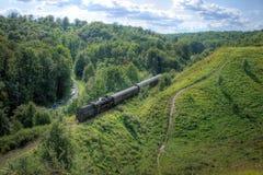 Paisaje con un tren del vapor Imagenes de archivo