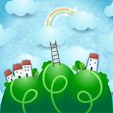 Paisaje de la fantasía con el pueblo y el arco iris Imágenes de archivo libres de regalías