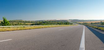 Paisaje de la mañana con la carretera Fotografía de archivo libre de regalías