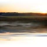 Paisaje de la puesta del sol con niebla Fotografía de archivo