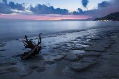 Paisaje de la puesta del sol de la playa Foto de archivo