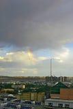Paisaje de una pequeña ciudad en China occidental con el arco iris Fotos de archivo libres de regalías