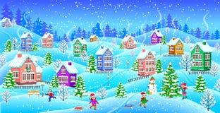 Paisaje del invierno con el muñeco de nieve nevado de los niños de las casas Imágenes de archivo libres de regalías