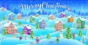 Paisaje del invierno con las casas nevadas y el te de la Feliz Navidad Foto de archivo