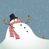 Paisaje del invierno con un muñeco de nieve Imagen de archivo