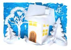 Paisaje del invierno con una casa hecha del papel Anillo plástico de papel Fotos de archivo libres de regalías