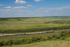 Paisaje del verano con el ferrocarril Foto de archivo libre de regalías