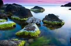 Paisaje hermoso en la puesta del sol en la playa Imágenes de archivo libres de regalías