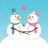 Paisaje Nevado con los muñecos de nieve lindos en amor Fotografía de archivo